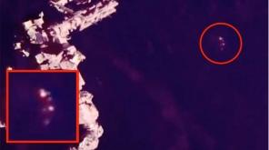 Strange Glowing Triangular UFO Made A Visit To ISS. Image Credit:Scott C Waring