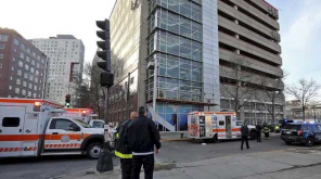 A woman and two kids dead near a parking garage in Boston. Photo AP.